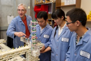 Gregory Chirikjian (Far Left) with his Students Photo Credit- Will Kirk, JHU